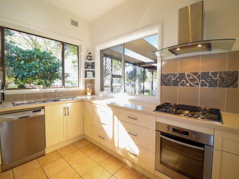 Modern fully equipped kitchen at A reflection on the lake at Swansea