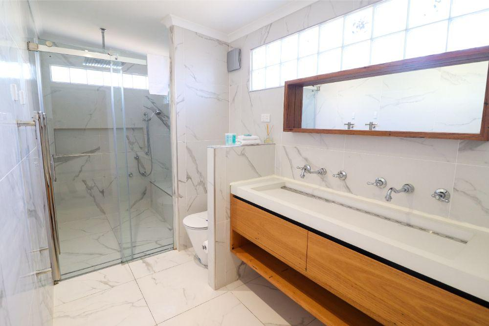 Modern bathroom with double vanity and shower