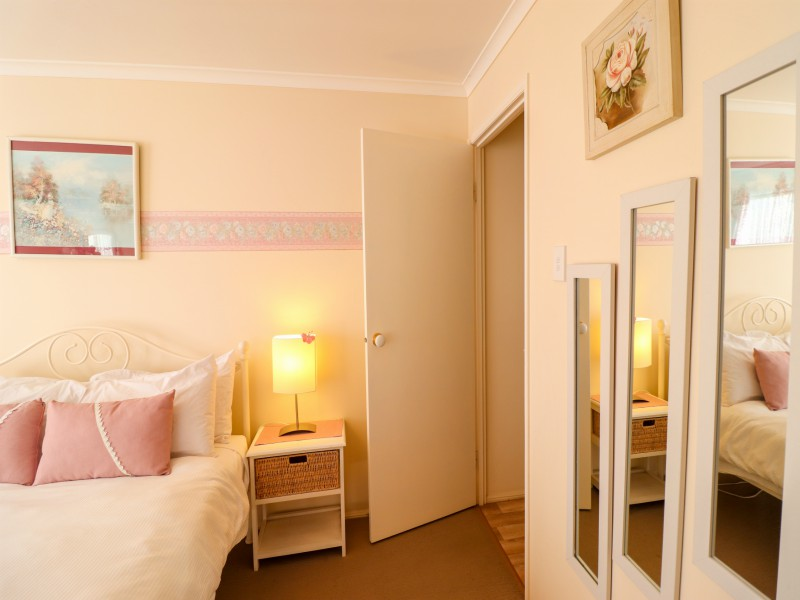 The main bedroom at  is spacious and airy at Bromyard Cottage at Swansea