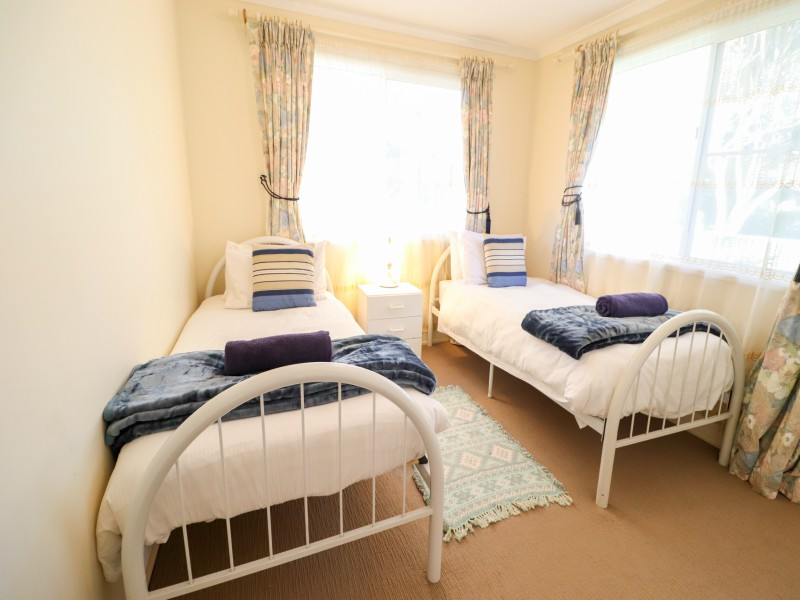 Second bedroom in Bromyard Cottage at Swansea with 2 single beds