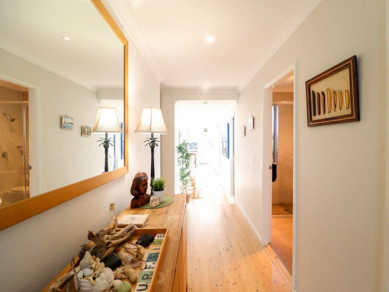 Surfside at Caves has floorboards and a welcoming entry