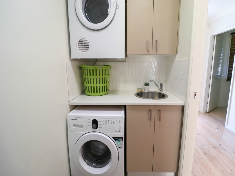 Laundry with washing machine and dryer at surfside